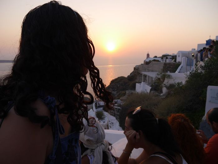 Sunset Outdoors Budget Traveller Sunlight Nature Sea Togetherness Water Friendship Day Travel Destinations Tourism Tourist Destination Summeringreece Santorini, Greece Live For The Story The Photojournalist - 2017 EyeEm Awards The Portraitist - 2017 EyeEm Awards The Great Outdoors - 2017 EyeEm Awards EyeEm Selects The Week On EyeEm Breathing Space Investing In Quality Of Life I celebrated my 30th birthday in Greece and tug along a friend with the condition that I will be the one who will lmake the itinerary. So I did. Your Ticket To Europe Mix Yourself A Good Time