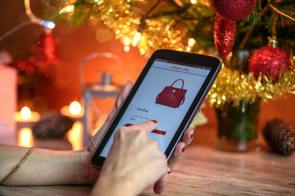 Modern Christmas e-shopping. Woman makes Christmas shopping via smartphone in the online e-store. Christmas Christmas Decoration Christmas Lights Discount Ecommerce Female Gift Home Human Hand Illuminated Internet Market Mobile Phone Onlineshop Onlineshopping Present Purchase Red Lips Sale Shopping Smart Phone Streetphotography Tablet Trends Woman