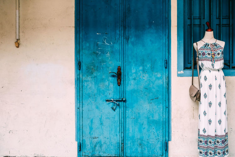 Closed blue door of building, kampong glam, singapore