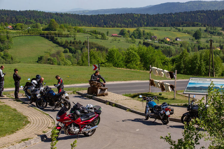 Bieszczady Mountains Tourist Attraction  Bieszczady Biker Day Green Color Group Of People Headwear Helmet Land Vehicle Landscape Mode Of Transportation Motorcycle Mountain Nature Outdoors People Plant Real People Riding Road Sport Sports Helmet Tourism Transportation Tree Wild Nature