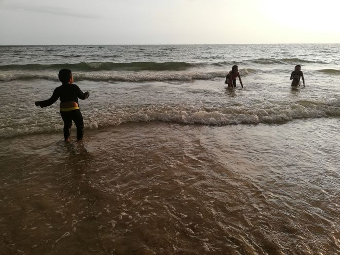 Children enjoy on summer trip 2019,หาดเจ้าหลาว Achi2019 Sea Water Horizon Over Water Horizon Sky Beach Land Real People Lifestyles Leisure Activity Beauty In Nature Scenics - Nature Nature Motion Rear View People Group Of People Men Wave Outdoors