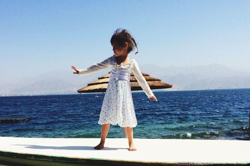 Girl dancing on seashore