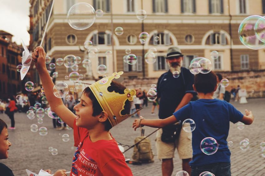 The Street Photographer - 2017 EyeEm Awards The Photojournalist - 2017 EyeEm Awards EyeEmNewHere Playing Bubble Enjoyment Boys Bubble Wand Fun Childhood Real People Day Togetherness Large Group Of People Child Outdoors People City Adult