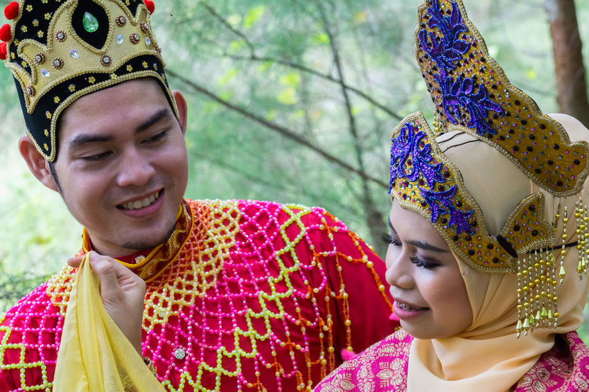 Specific to the villages of Kelantan, where the tradition originated, Mak Yong is performed mainly as entertainment or ritual purposes by couple of dancers. Celebration Close-up Costume Crown Day Happiness Headdress Headshot Headwear Lifestyles Mak Yong Outdoors People Period Costume Portrait Real People Smiling Stage Costume Standing Togetherness Traditional Clothing Two People Young Adult Young Women