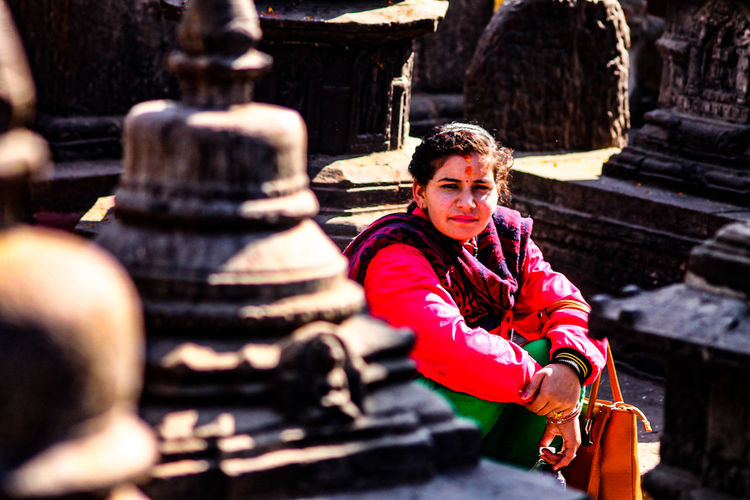 Kathmandu, Nepal Swayambhunath Place Of Worship People Warm Clothing Tradition Adults Only Young Adult Front View Only Women One Person Close-up Portrait Of A Woman Nepalee Woman Day Architecture Street Photography Culture And Tradition Travel Photography Travel People Photography Real People Beautiful Woman