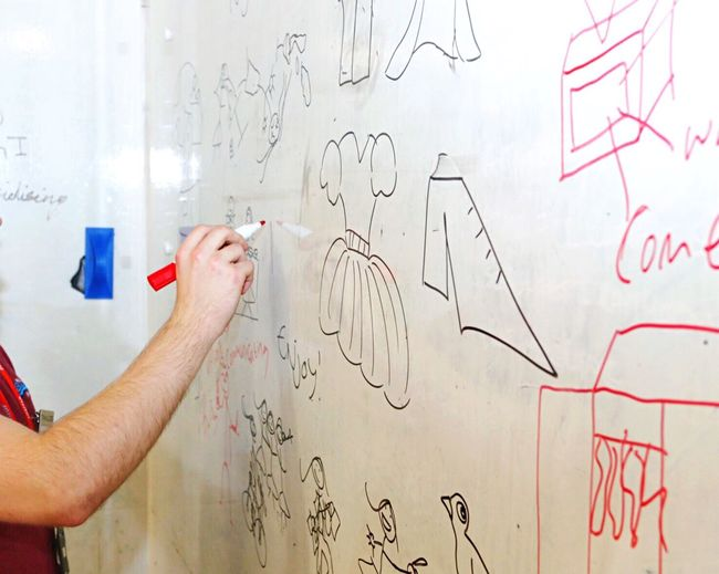 Creativity Human Hand Holding Drawing - Activity Human Body Part Drawing - Art Product Education Whiteboard One Person Indoors  Paper Mature Adult Real People Scribble Men Women Handwriting  People Adult Day