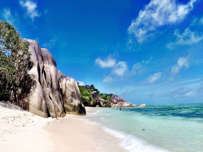 Beach Sky Sea Beauty In Nature Scenics Nature Sand Tranquility Tranquil Scene Blue Cloud - Sky No People Day Water Horizon Over Water Tree Landscape Outdoors Anse Source D'argent Best Beach In The World Crystal Clear Waters Gopro Seychelles Islands Seychelles Rocks And Water