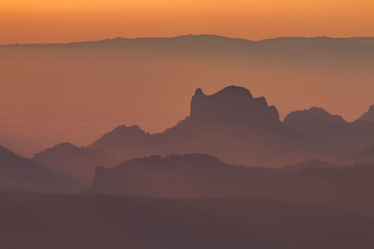 Layer of mountains with misty in morning