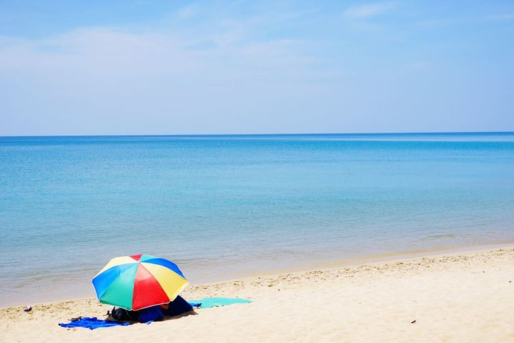 Connected By Travel Beach Sand Sea Summer Vacations Water Horizon Over Water Sunny Blue Relaxation Nature Outdoors Tranquility Weekend Activities Multi Colored No People Sky Day Heat - Temperature Clear Sky Phuket,Thailand Phuket Beach Umbrella