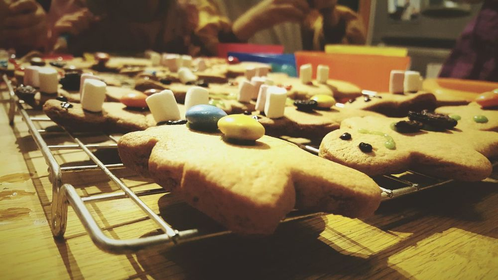 This Is Christmas day 2. Gingerbread Men Women Wiggly Worms Baking Indoors  Table Close-up In The Kitchen Christmas Activities