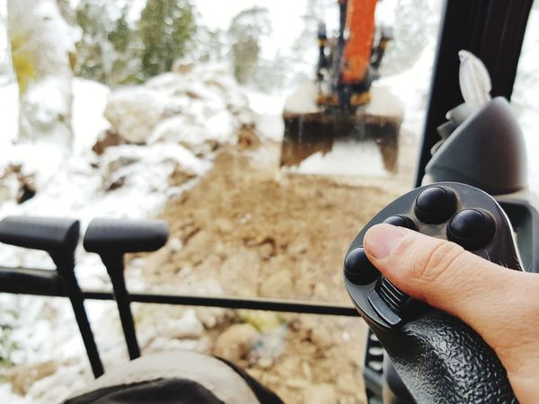 heavy equipment excavator POV Heavy Equipment Excavator Digger Construction Construction Site POV Point Of View Interior Human Hand One Person Human Body Part Real People Holding Winter People Focus On Foreground Day Adults Only Lifestyles Cold Temperature Snow