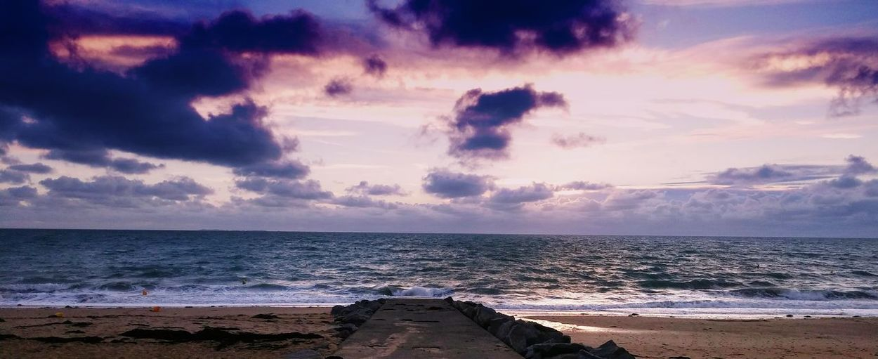 Sea Beach Water Cloud - Sky Horizon Over Water Sky Sunset Scenics No People Beauty In Nature Outdoors Nature Sand Wave Tranquility Travel Destinations Day Vacations Summer Exploratorium