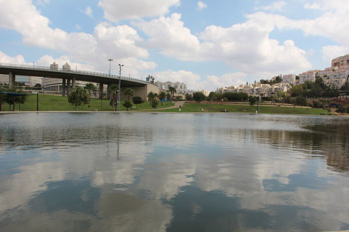 Artificial lake of Modiin city, Israel Clouded Sky Modiin, Israel Bridge - Man Made Structure Buildings City Cloud - Sky Clouds Day Lake No People Outdoors Reflection Sky Skyscraper Water EyeEmNewHere Adventures In The City
