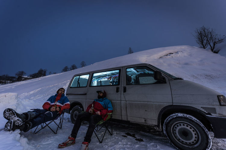 Snow Cold Temperature Winter Real People Land Vehicle Group Of People Transportation Men Child Mode Of Transportation Nature Sky Lifestyles Leisure Activity Childhood Sitting Day Boys Mountain Warm Clothing Snowcapped Mountain