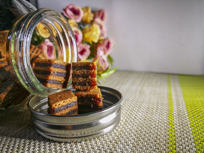 Closeup and selective focus a Sarawak Layer Cake or local called Kek Lapis with minimal lighting and flare serve on the top of table. Sarawakmalaysia Layer Cakes Food And Drink Food Freshness Table Indoors  Focus On Foreground Still Life No People Ready-to-eat Close-up Healthy Eating Tablecloth Plate Jar Sweet Food Glass - Material Wellbeing Bowl Serving Size Indulgence Temptation Snack