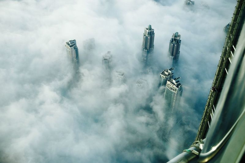 Aerial view of buildings and cloudscape