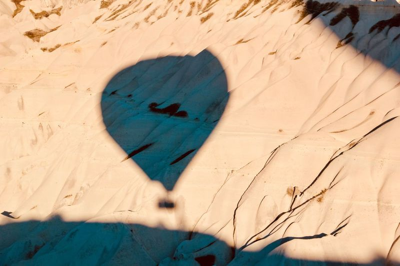Shadow of or Passinh Shadow Hot Air Balloon EyeEm Selects Sand Heart Shape Love Land Positive Emotion Sunlight Nature Day Shadow High Angle View No People Creativity Summer Close-up Plant Outdoors