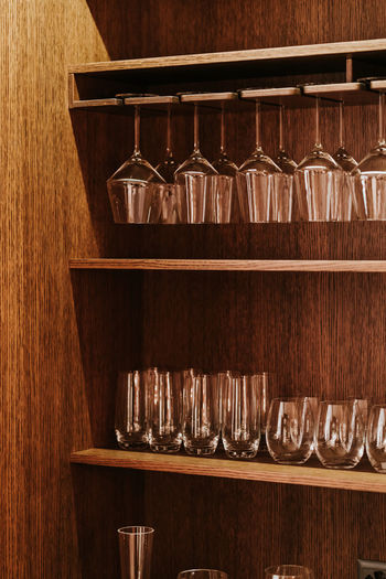 Wood - Material Shelf Indoors  In A Row Variation Arrangement Bar - Drink Establishment No People Choice Household Equipment Large Group Of Objects Container Kitchen Utensil Order Food And Drink Table Brown Close-up Group Of Objects Glass Antique Bar Counter Crockery Wood Grain