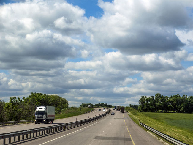 """Highway """"South"""" near Novovoronezh, Russia Car Cargo Cloud - Sky Day Highway Industry Land Vehicle Mode Of Transport Nature No People Outdoors Road Scenics Sky South The Way Forward Transportation Tree Truck Wheel"""
