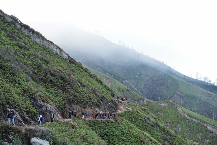 Travel Beauty In Nature Crater Crowd Day Environment Fog Group Of People Hiking Landscape Large Group Of People Leisure Activity Mountain Nature Outdoors Plant Real People Scenics - Nature Sky Tourism Tranquility Travel Destinations Tree Volcano Walking