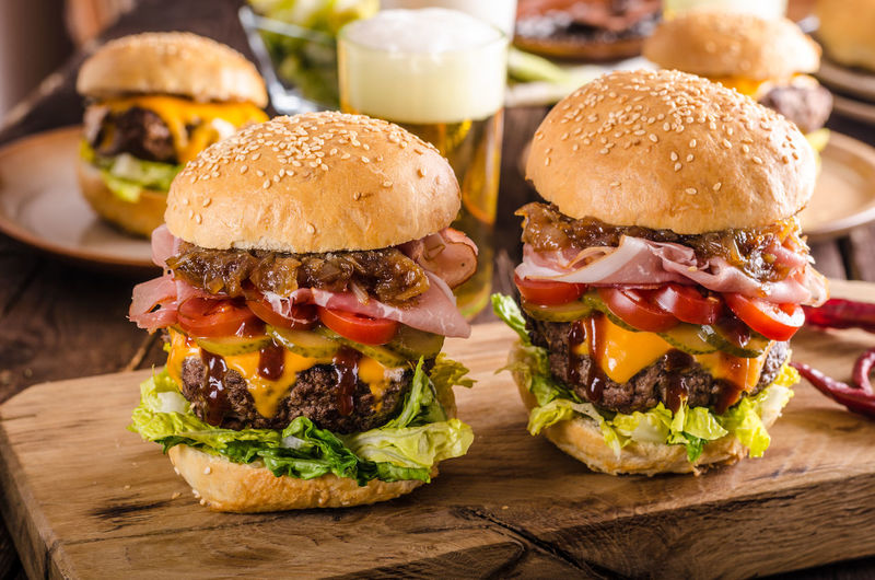 Close-up of burger on serving board at table