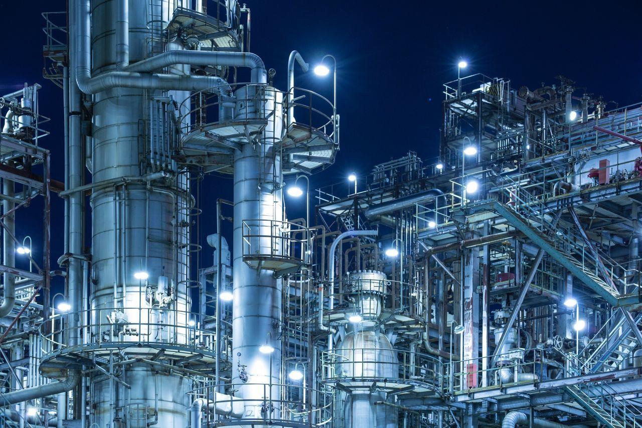 Illuminated Refinery Factory At Night