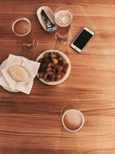 Table Coffee - Drink High Angle View Food And Drink Wood - Material Drink Indoors  Plate Directly Above Coffee Cup Refreshment No People Indulgence Wireless Technology Croissant Drinking Glass Sweet Food Food Freshness Day