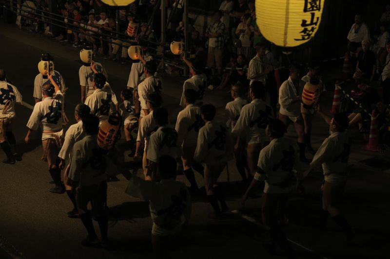 High angle view of people on street in city at night