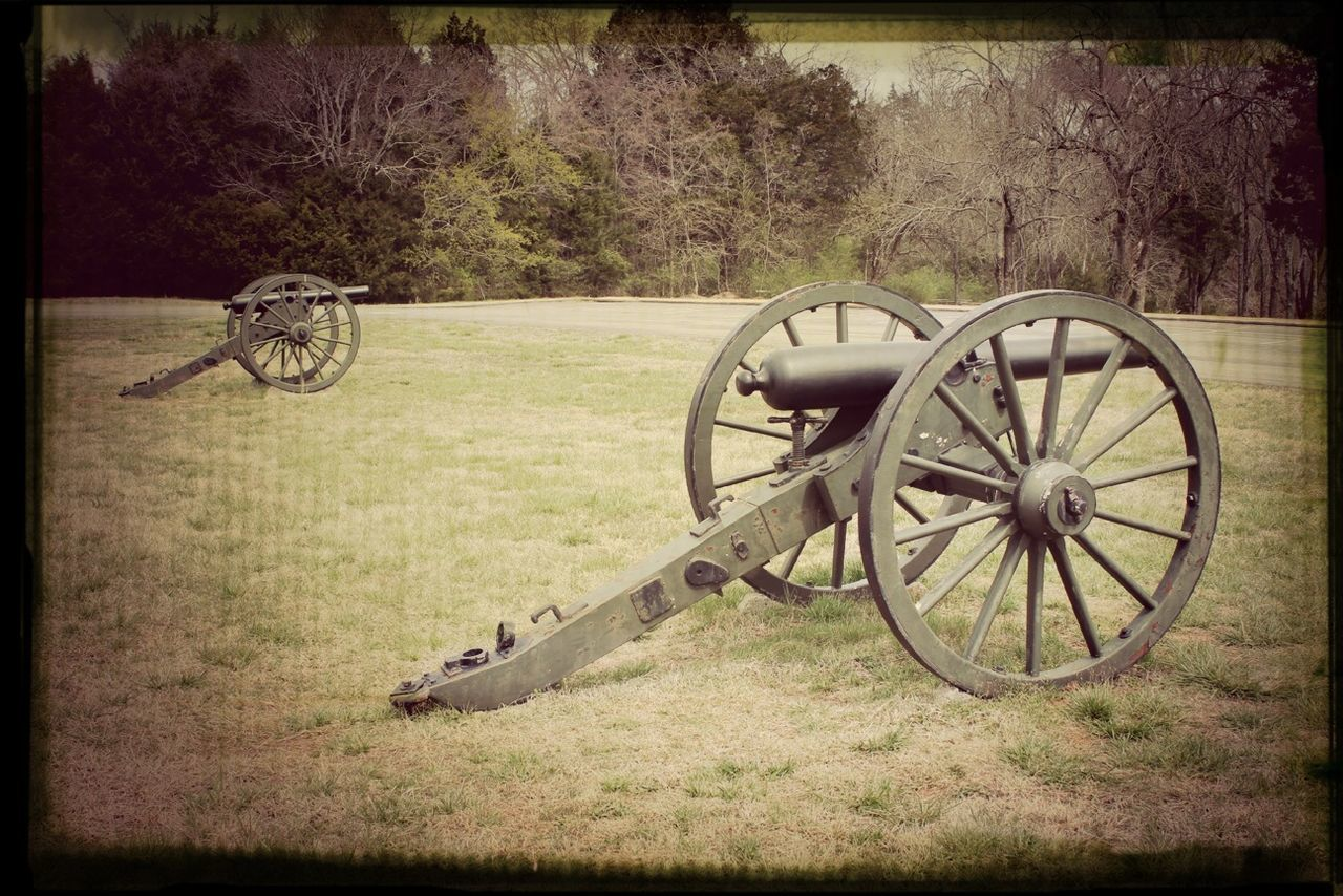 weapon, war, grass, military, wheel, cannon, history, auto post production filter, field, wagon wheel, canon, old-fashioned, transportation, gun, abandoned, day, no people, outdoors, army, tree, nature