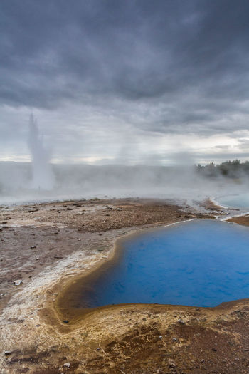 This is no bad photoshop ;) a chemical reaction creates this incredible blue color at the Geysir in Iceland. Beach Beauty In Nature Cloud - Sky Day Geyser Geysir Grey Sky Horizon Over Water Hot Spring Iceland Lagoon Nature No People Outdoors Sand Scenics Sea Sky Tranquility Travel Vacations Water Water Reflections