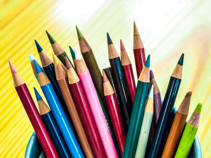 Multicolored pencils are combined in a steel box on a desk in the office. Art Background Blue Bright Brown Closeup College Color Colored Colorful Colors Colour Concept Crayon Crayons Creative Design Draw Drawing Education Equipment Frame Green Group Image Isolated Macro Object Office Orange Paint Palette Pen Pencil Pencils Rainbow Red Row School Set Sharp Stationery Supplies Up Variation Vector White Wood Wooden Yellow Multi Colored Art And Craft Writing Instrument Choice Large Group Of Objects Still Life Close-up Craft No People Colored Pencil Indoors  Creativity Art And Craft Equipment High Angle View Wood - Material Vibrant Color Side By Side Focus On Foreground Variety Self Improvement