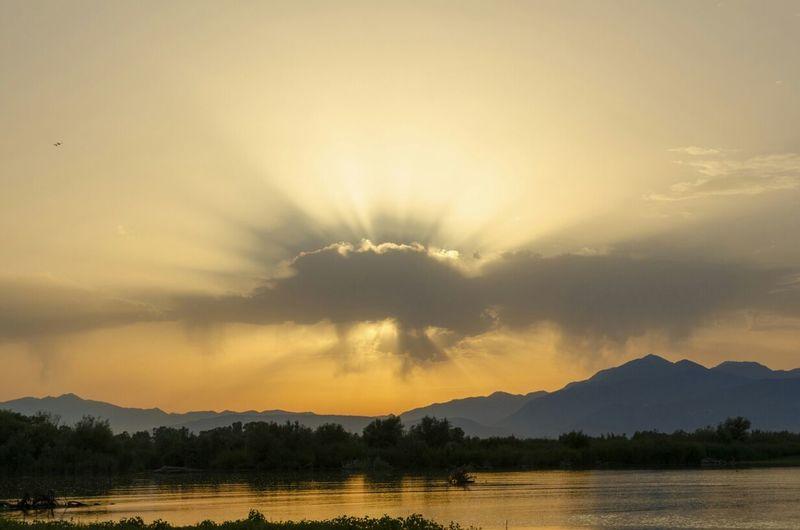 Scenic Sunset Over Mountain Lake