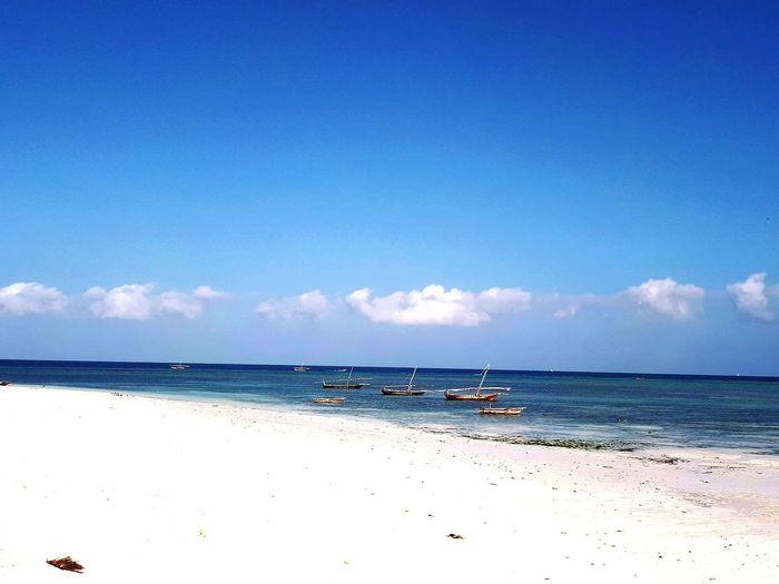 Beach Sand Blue Sunny Sky Tranquil Scene Travel Destinations Nautical Vessel Landscape Vacations