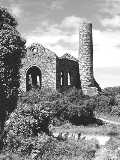 Built Structure History Architecture Ancient Day Building Exterior Outdoors No People Travel Destinations Grass Sky Nature Cornish Tin Mine Revolution Cornwall Uk Cornwall Cornishmine Architecture Arch Blackandwhite Photography Black & White Blackandwhite Grass