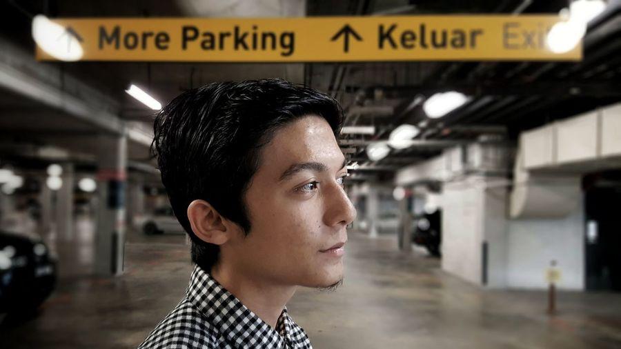 Man standing at parking lot