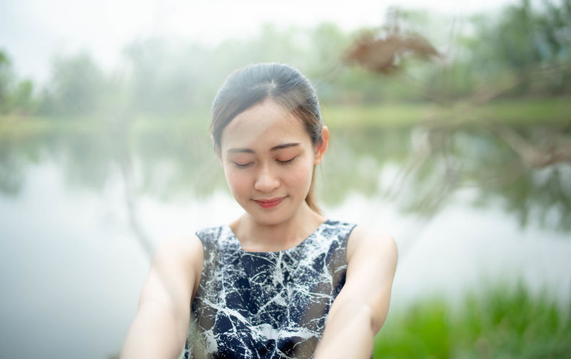 One Person Front View Young Adult Young Women Leisure Activity Beauty Water Looking Down Casual Clothing Focus On Foreground Looking Real People Plant Lifestyles Day Women Beautiful Woman Waist Up Outdoors Hairstyle