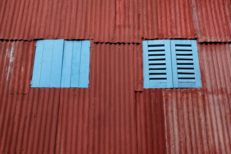 Old rustic folding old metal door gate. Architecture Backgrounds Blue Building Building Exterior Built Structure Closed Corrugated Corrugated Iron Day Full Frame Iron Metal No People Old Outdoors Pattern Sheet Metal Shutter Window Wood - Material