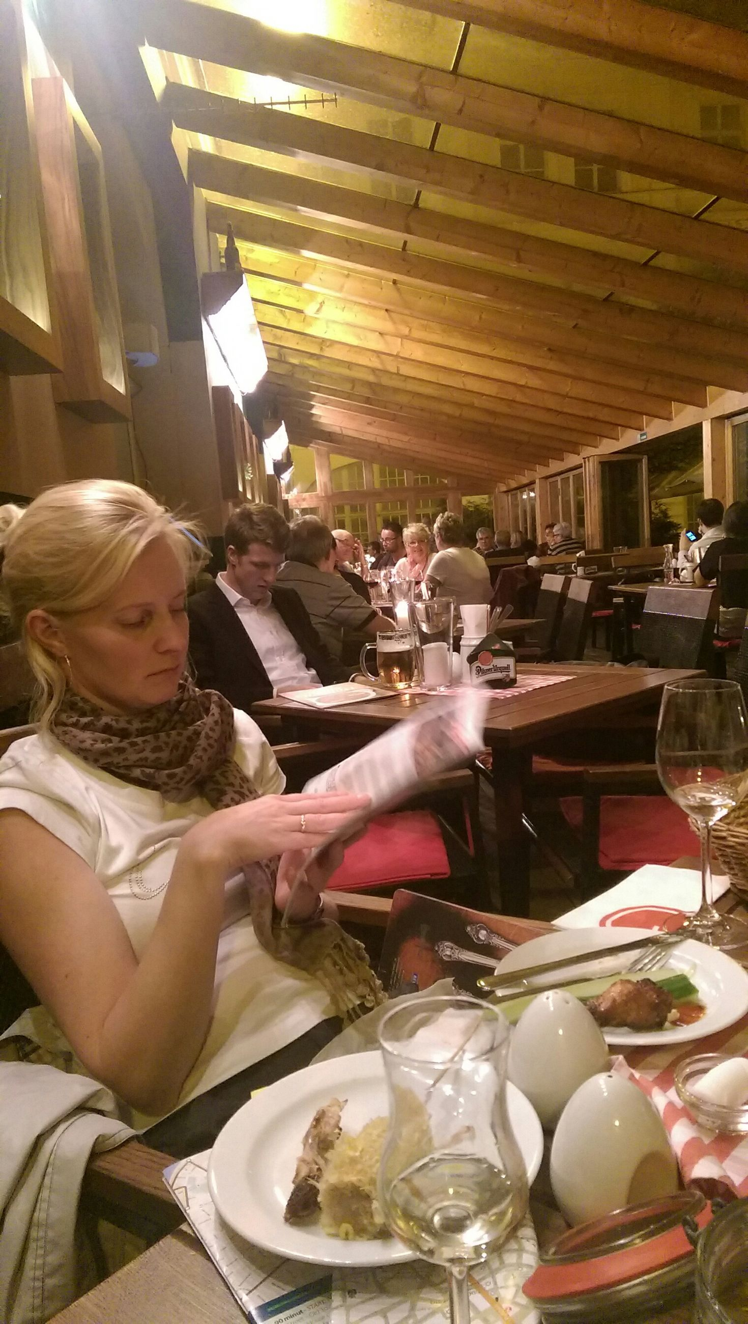 indoors, table, sitting, restaurant, lifestyles, food and drink, leisure activity, chair, drink, casual clothing, freshness, person, place setting, holding, wineglass, drinking glass
