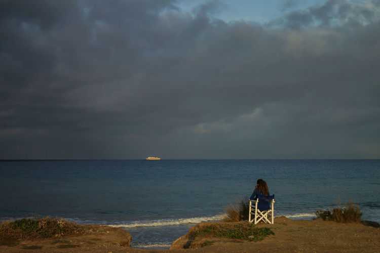 gazing out over the sea Beach Beauty In Nature Cloud - Sky Couple - Relationship Horizon Horizon Over Water Land Leisure Activity Nature Outdoors People Real People Rear View Scenics - Nature Sea Sitting Sky Tranquility Two People Water