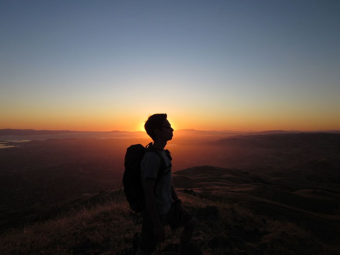 Side view of a silhouette man on landscape