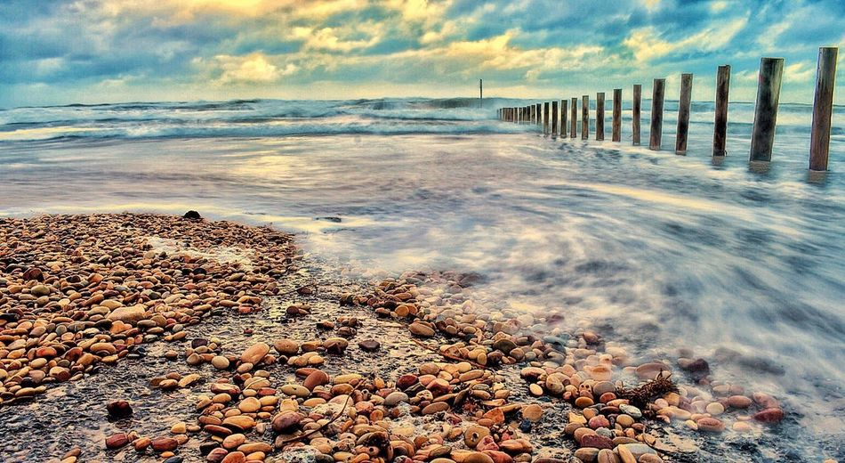 Sea Beach Shore Water Cloud - Sky Pebble Sky Horizon Over Water Nature Outdoors No People Sand Sunset Day Beauty In Nature Pebble Beach