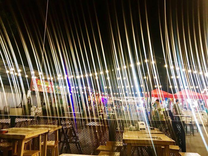 Panoramic view of illuminated store at night