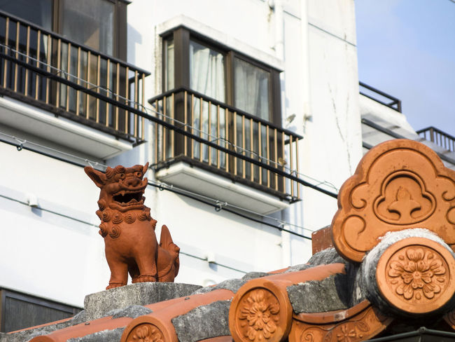 Shisa statue in Miyakojima, Japan Animal Themes Architecture Building Exterior Built Structure Charm Day Figure Guardian Japan Lion Low Angle View Mammal Miyako Miyakojima No People Okinawa Outdoors Pacific Ryukyu Sculpture Shisa Singha Statue Statue Traditional Culture