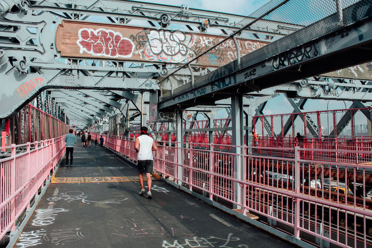 Architecture Bridge City City City Life Creativity Day Elevated Walkway Footbridge New York New York City Railing Railroad Station Railway Station Rear View Signboard Text The Way Forward Travel USA Walking Western Script Williamsburg Bridge Wrought Iron