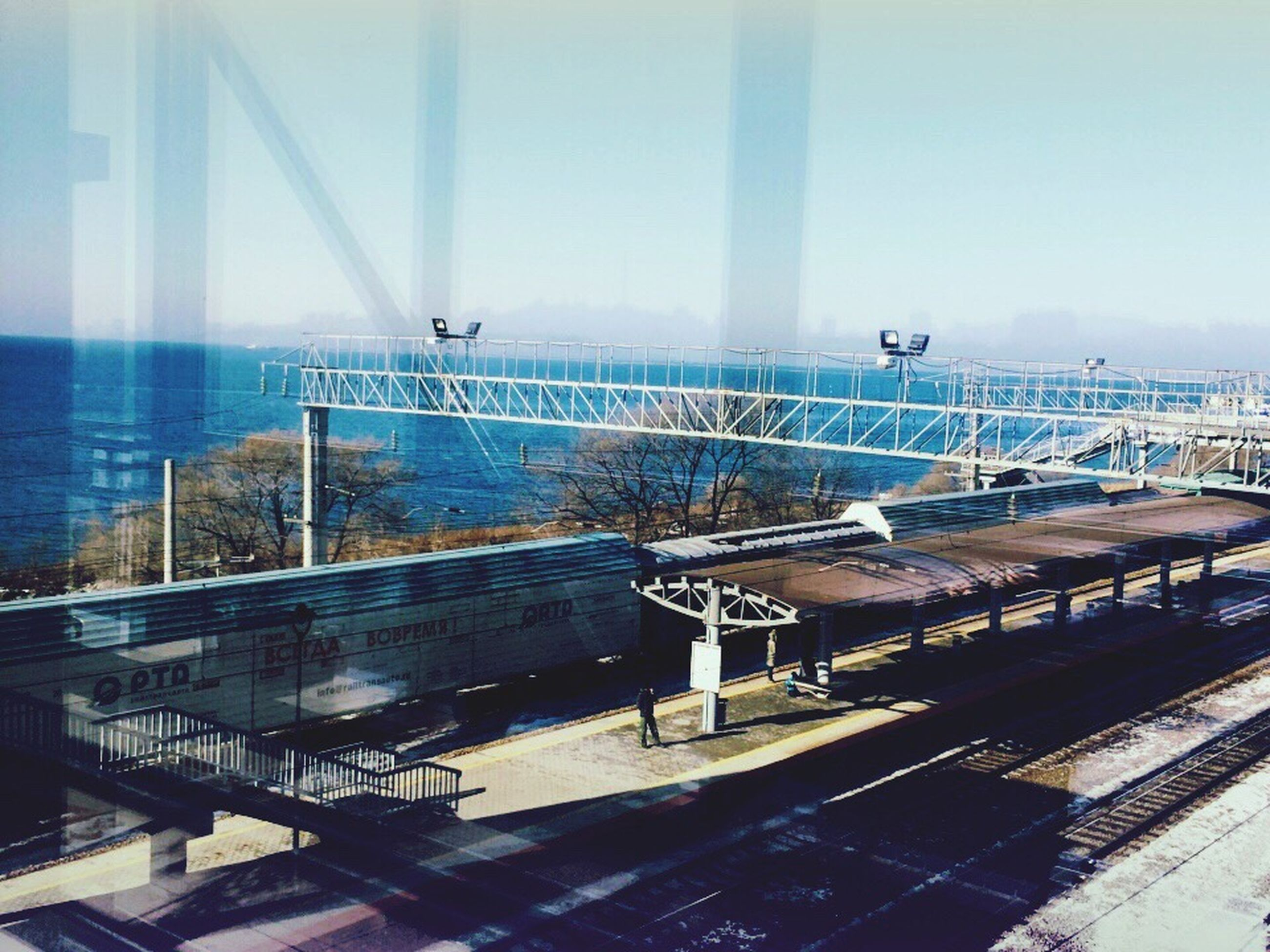 built structure, sea, architecture, sky, railing, day, outdoors, water, no people, building exterior, bridge - man made structure, city, horizon over water, nature, passenger boarding bridge
