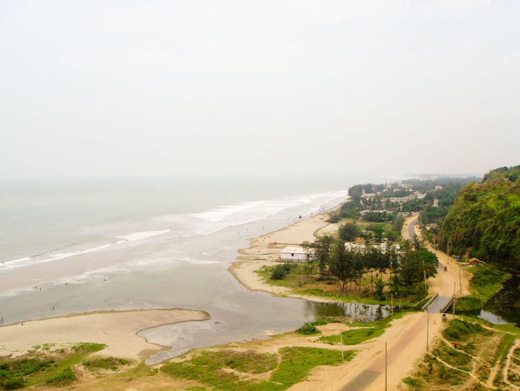 Part of the longest sea beach of the world (Cox's Bazar, Bangladesh) Bangladesh Beach Beauty In Nature City Cox's Bazar Day Horizon Over Water Landscape Nature No People Outdoors Road Sand Scenics Sea Sky Tree Water