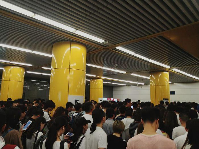 Group of people waiting on railway station platform