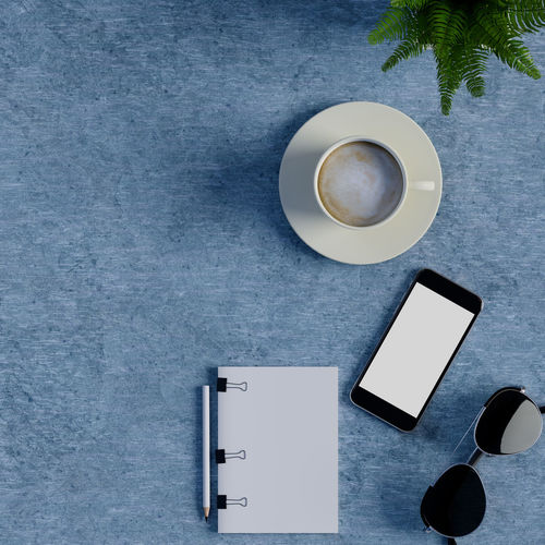 Mock up notebook and smart phone on table. Cup Drink Mug Coffee Cup Refreshment Table Coffee Coffee - Drink Food And Drink Technology Still Life Directly Above No People Communication Connection Indoors  Wireless Technology Smart Phone White Color Portable Information Device Crockery Blank Tea Cup Non-alcoholic Beverage