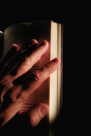 Close-up of hand holding book