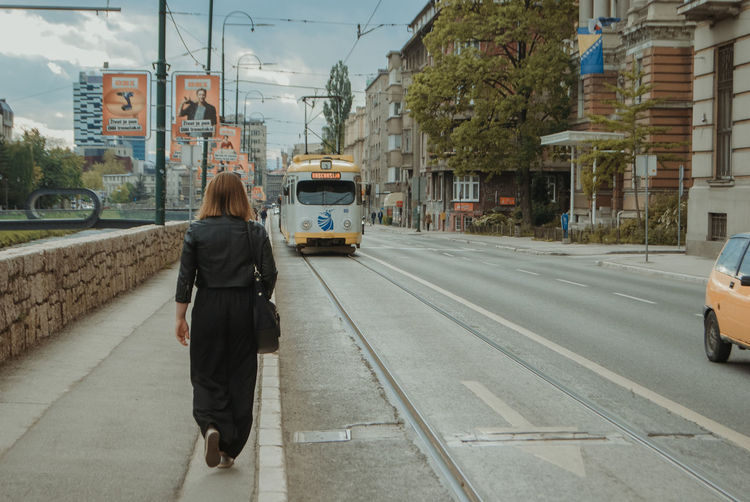 Rear view of woman on city street